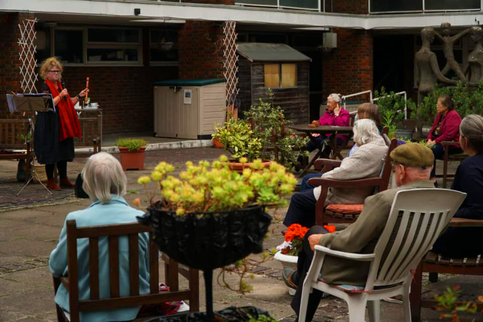 Musicians Performing for audience at care home