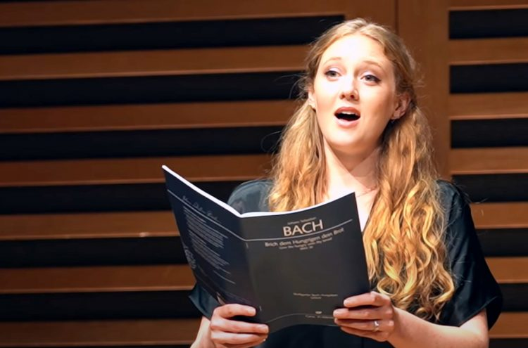 Capture of Bethany Horak-Hallet singing at Acland Burghley School.