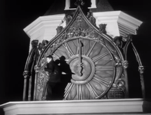 Marclay's The Clock is a chronological montage of moments in films that show the time – seen here is the climax of Orson Welles' The Stranger, representing midnight. The nature of the work makes it impossible to capture in still – authorship seems only to be Marclay's when we see the juxtaposition of clips in video form. (Image: Orson Welles/ Public Domain)